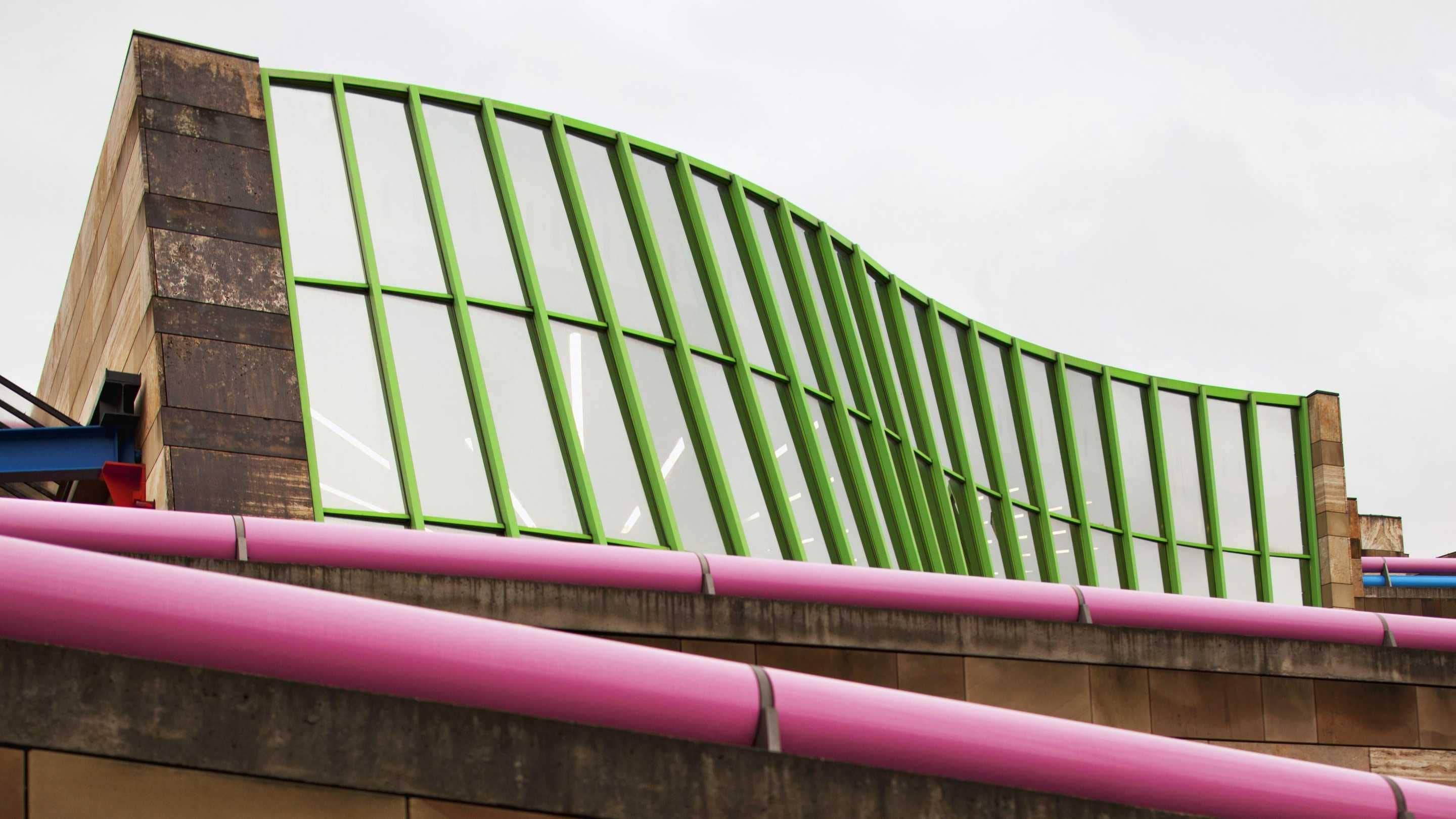 Exterior of Staatsgalerie with wavy windows and pink hand rails
