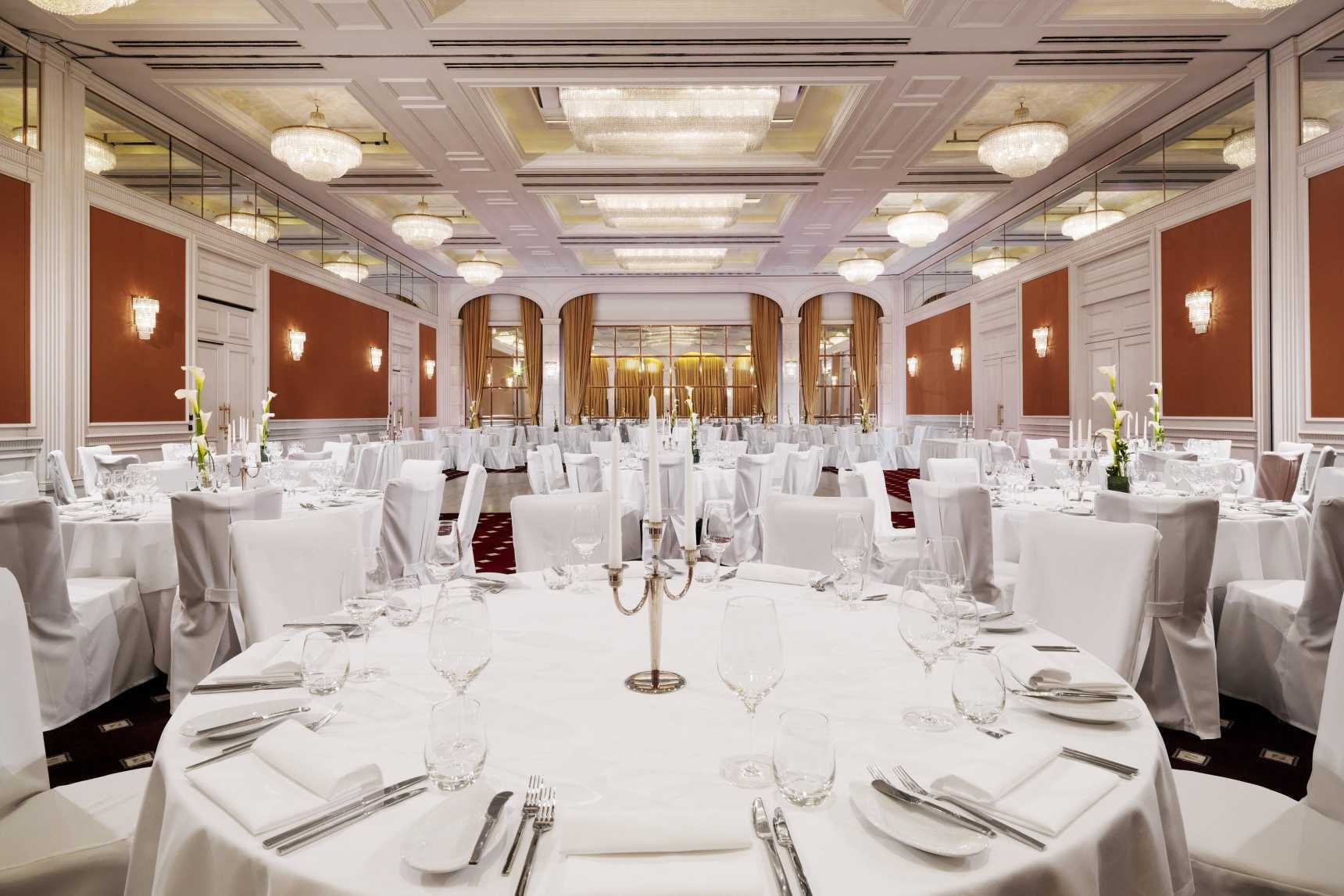 Gold Ballroom with white tables