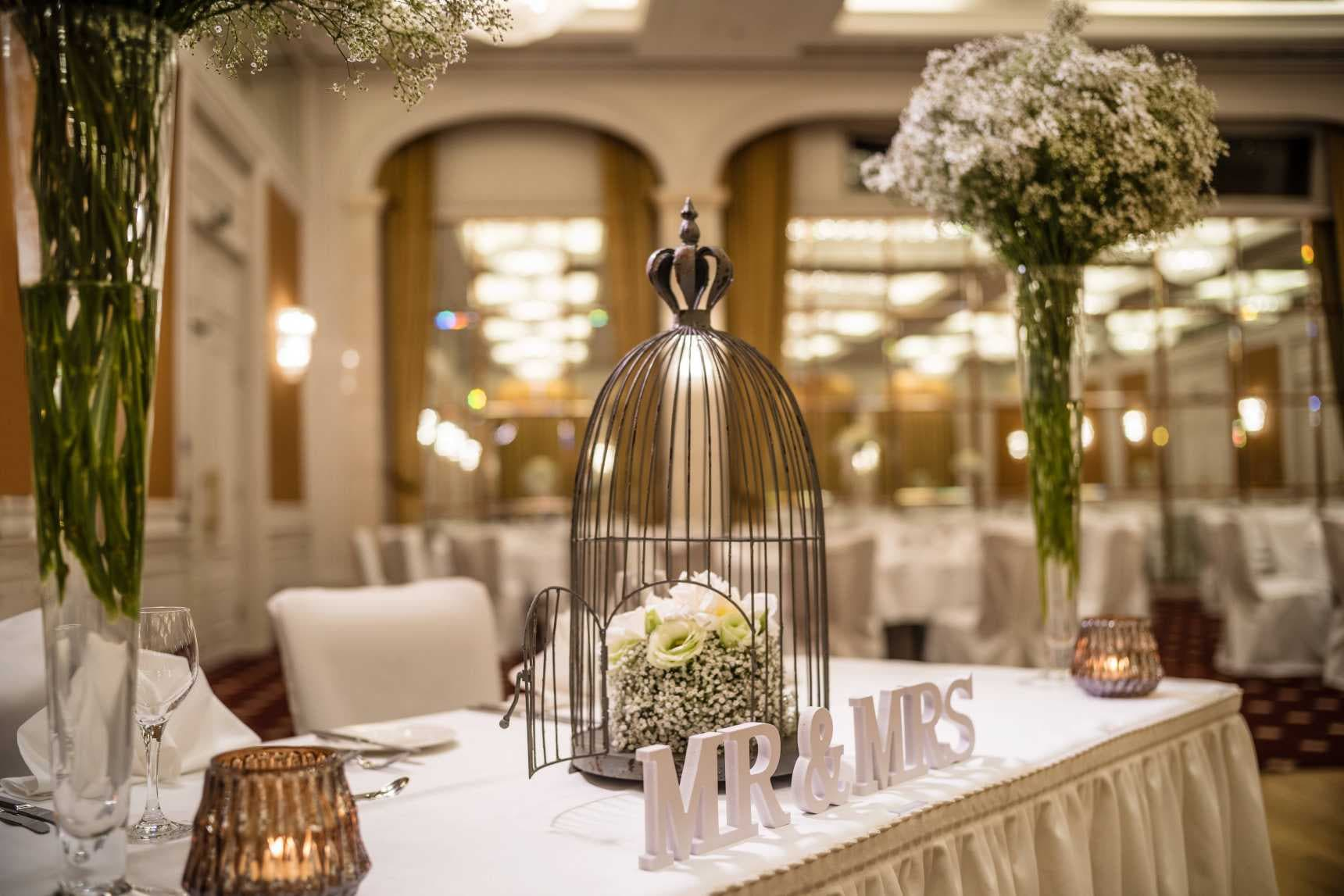 Table with candles and bird cage