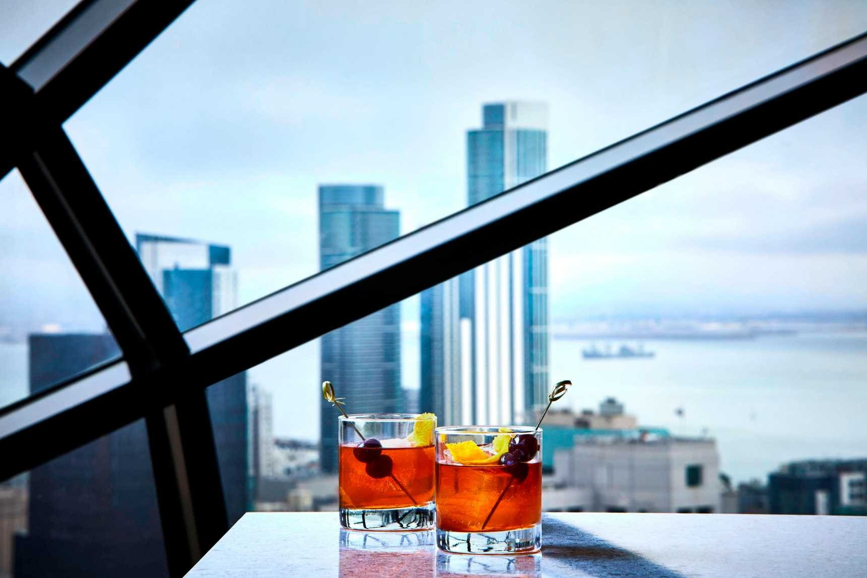 Cocktails in front of  window view of city