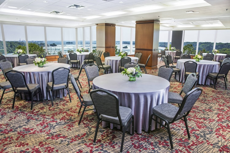 round tables with windows nearby overlooking falls