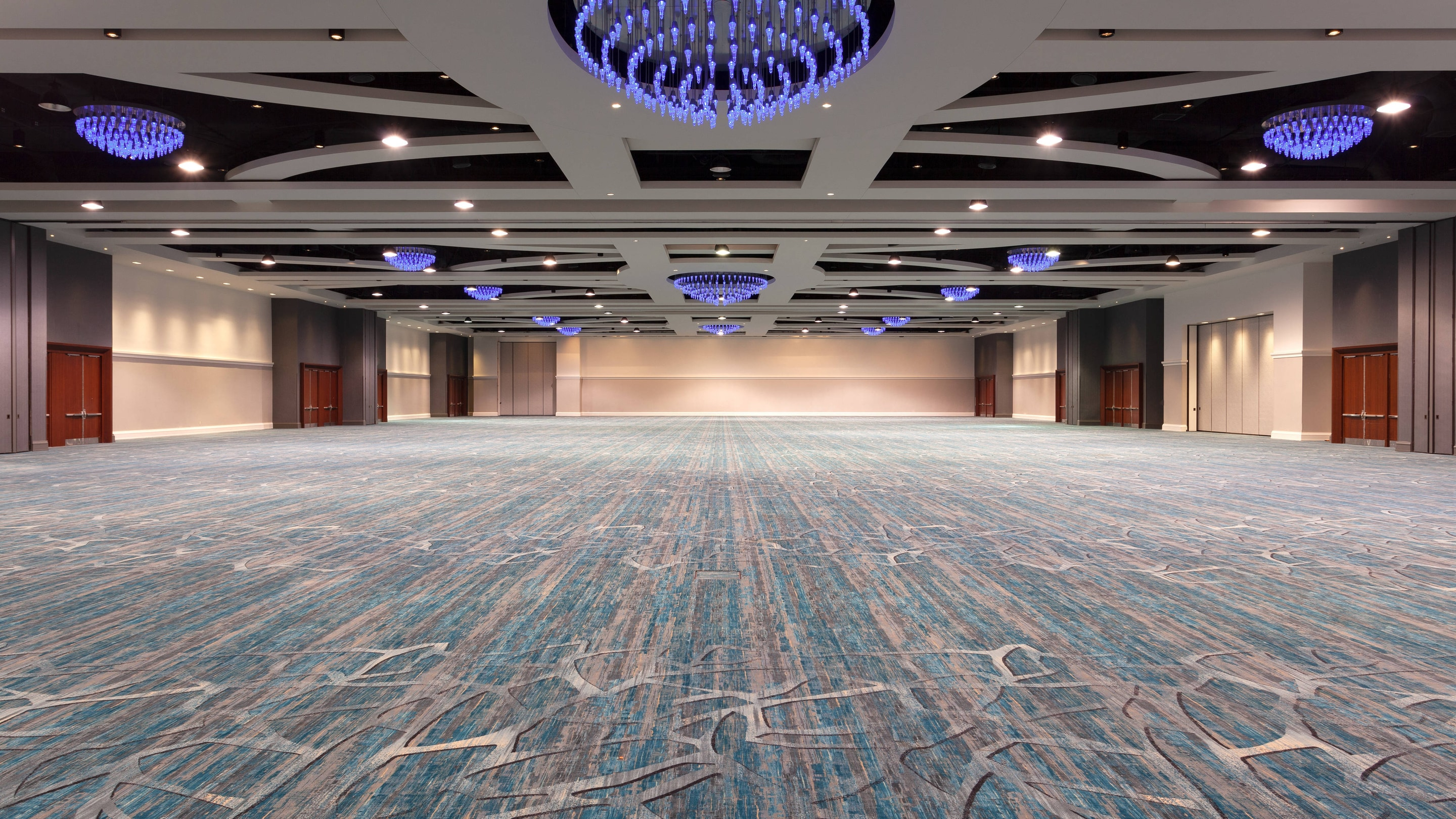 Large empty ballroom with blue lights above