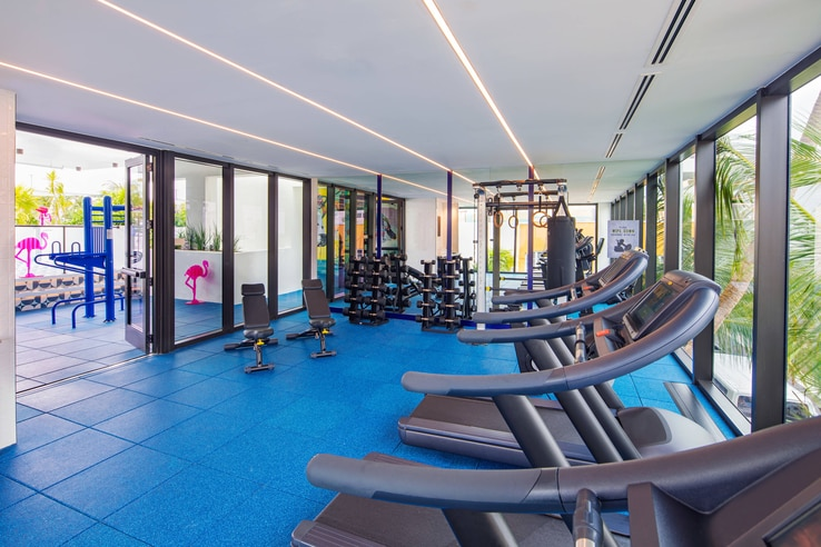 Moxy miami fitness center treadmills with floor-to-ceiling glass windows.