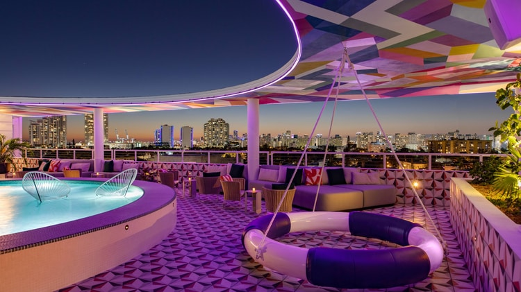 The upside rooftop bar and lounge area with colorful design and fun seating