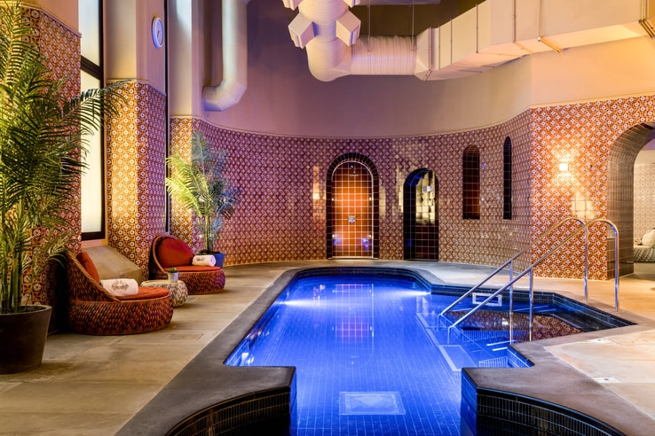 Expanded view of the indoor spa pool and seating.