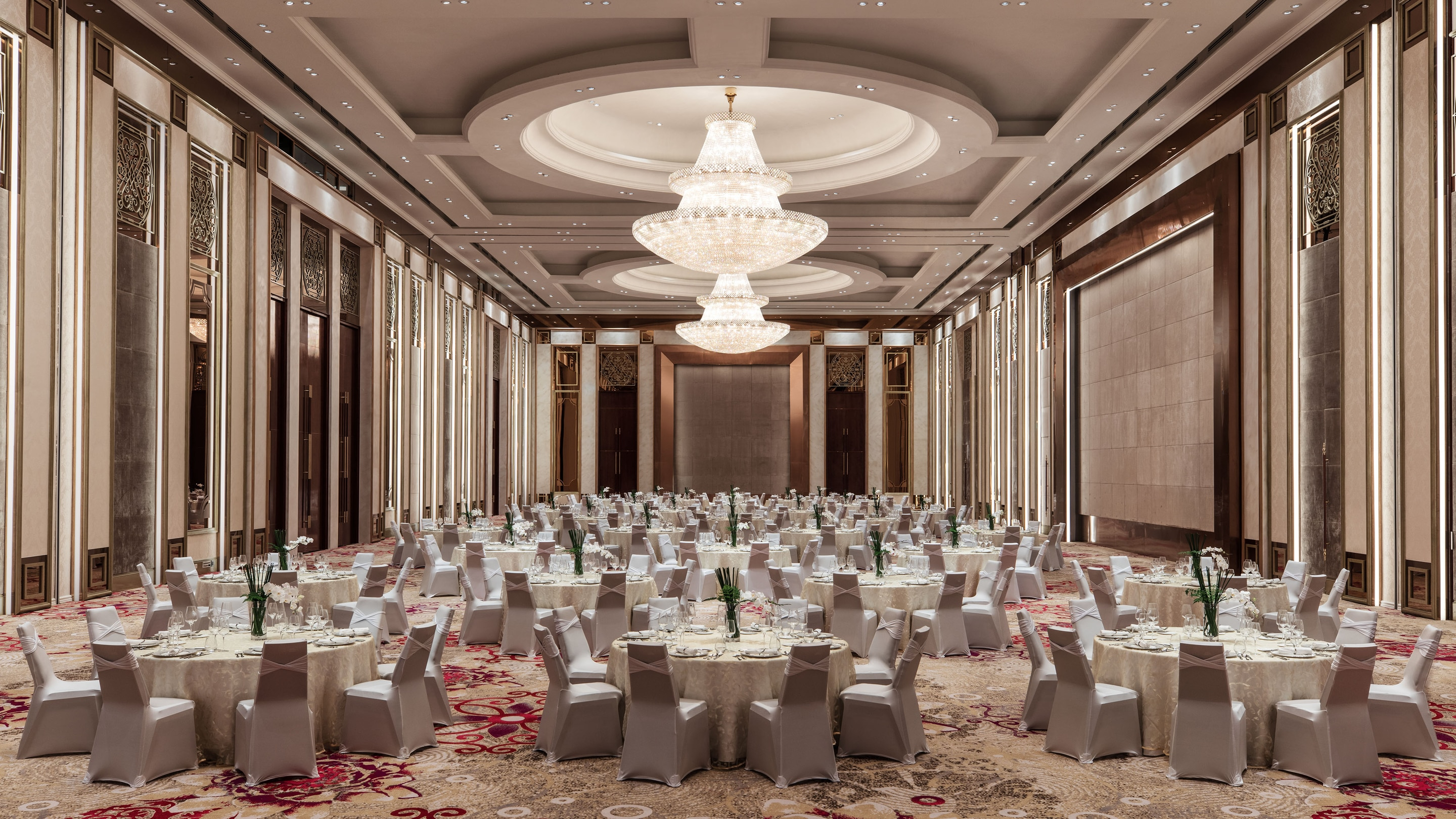Grand Ballroom filled with table set for a formal dinner.