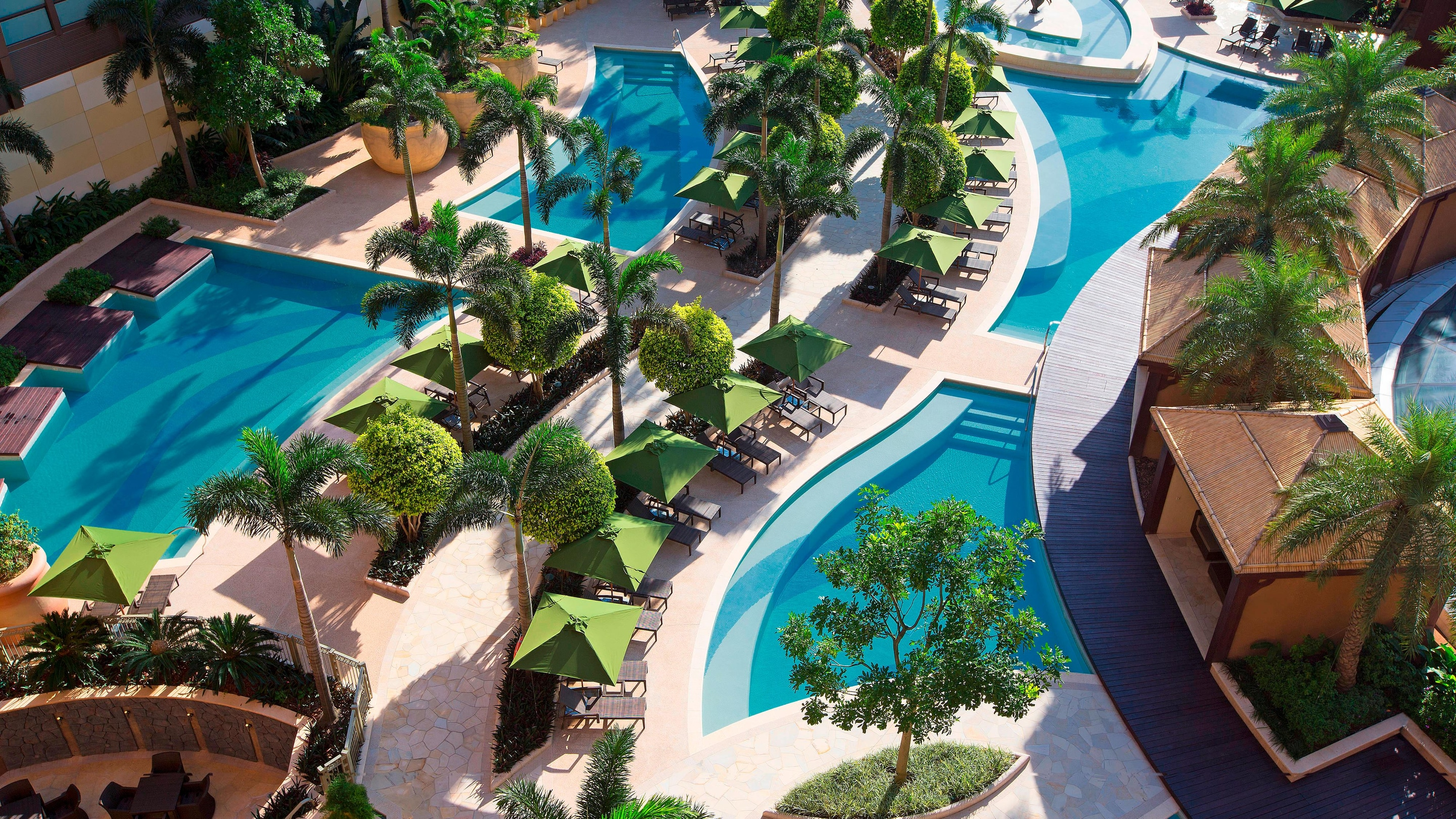 Aerial view of swimming pools, cabanas and foliage