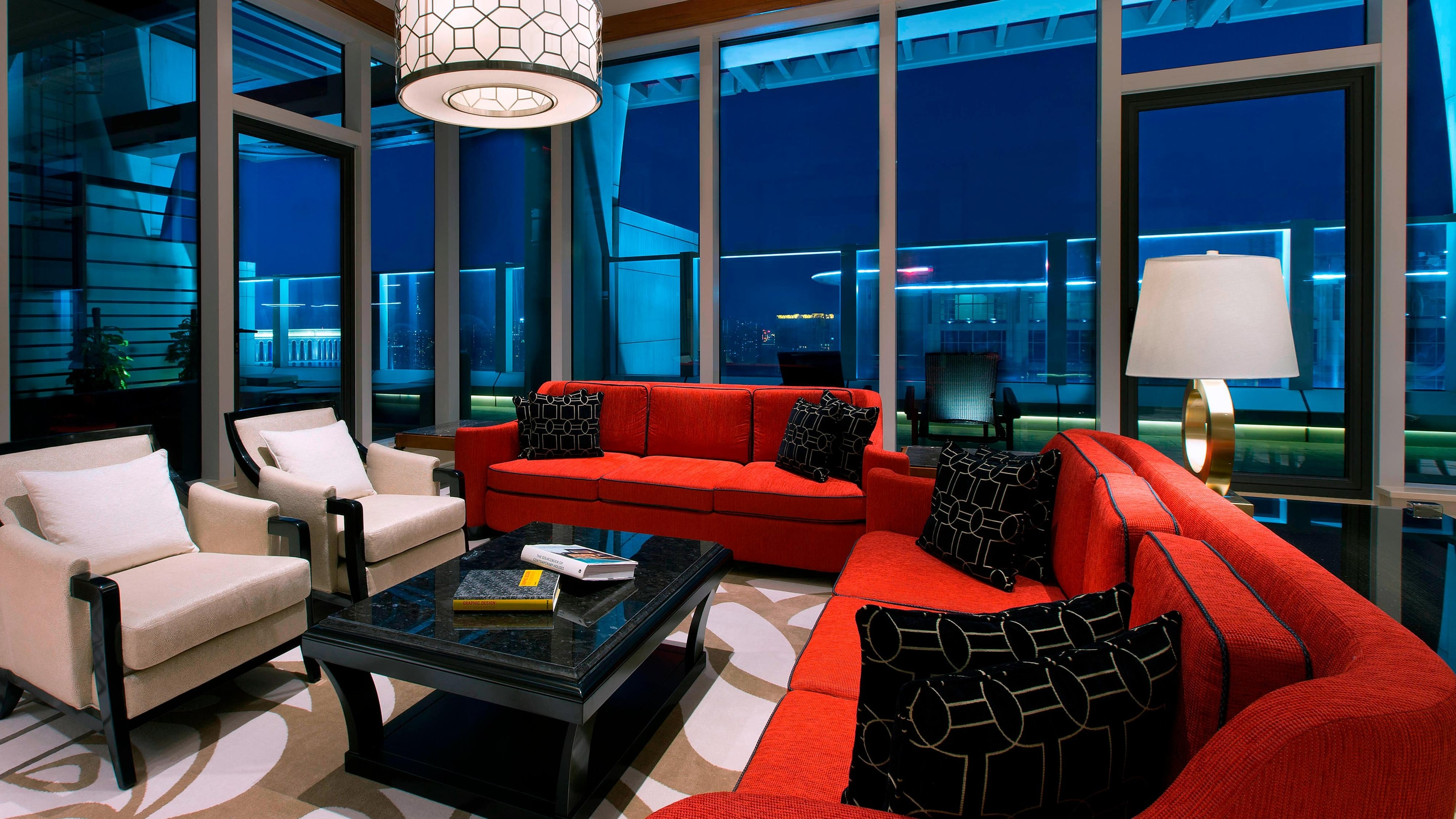 Terrace suite living area with seating and red couches