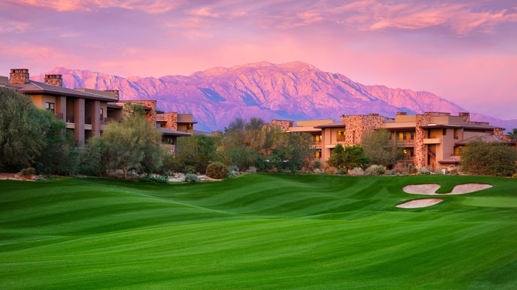 Desert Willow golf courses with view of mountain and resort buildings.