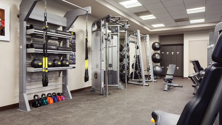 Small gym with fitness equipment.