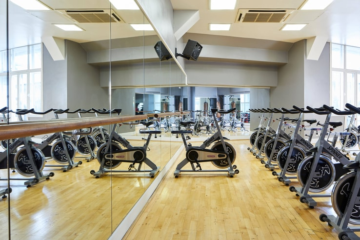 Marriott count hall fitness center spinning classes with bikes and mirrors.