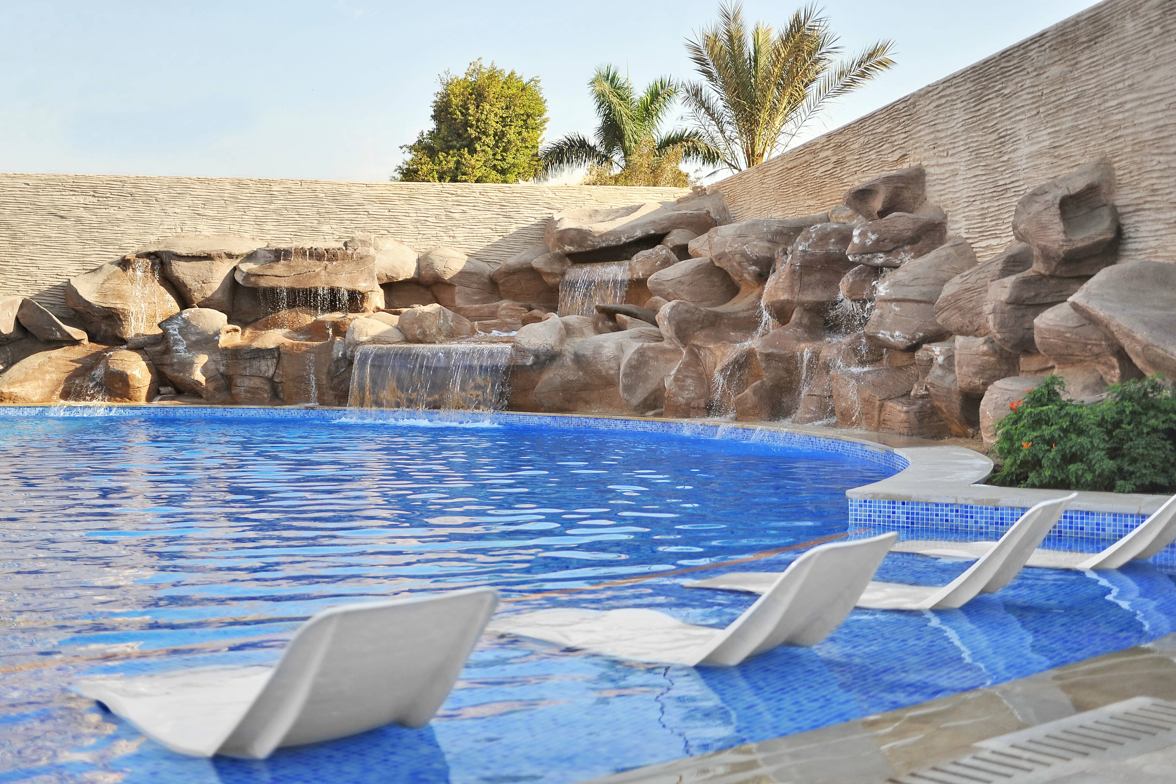 Waterfalls Pool - sun beds View